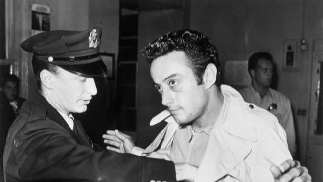 a-policeman-searches-comedian-lenny-bruce-after-bruces-arrest-for-allegedly-using-obscene-language-during-his-act-in-a-north-beach-nightclub-the-jazz-workshop-san-francisco-california